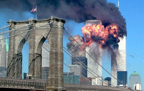 The second tower of the World Trade Center bursts into flames after being hit by a hijacked airplane in New York in this September 11, 2001 file photograph. Al Qaeda leader Osama bin Laden was killed in a firefight with U.S. forces in Pakistan on May 1, 2011, ending a nearly 10-year worldwide hunt for the mastermind of the Sept. 11 attacks. The Brooklyn bridge is seen in the foreground.  REUTERS/Sara K. Schwittek/Files (UNITED STATES - Tags: POLITICS CIVIL UNREST)