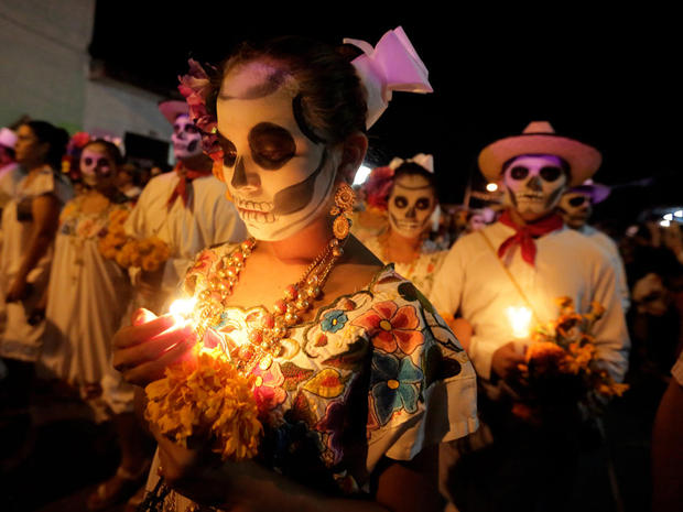 Residents+with+painted+faces+and+holding+candles+participate+in+El+Paseo+de+Las+Almas%2CThe+Walk+of+Souls%2C+during+a+Day+of+the+Dead+festival+in+Merida%2C+Yucatan%2C+Mexico+on+October+28%2C+2016.+%0AThe+Day+of+the+Dead+in+the+Mayan+area+is+called+%22Hanal+Pixan%22+in+Castilian%2C+meaning+food+of+souls+and+participants+start+the+parade+at+the+cemetery+and+walk+along+the+streets+with++painted+faces.+%2F+AFP+%2F+ALEJANDRO+MEDINA++++++++%28Photo+credit+should+read+ALEJANDRO+MEDINA%2FAFP%2FGetty+Images%29
