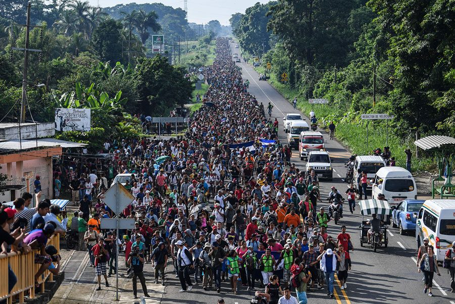 Honduran+migrants+take+part+in+a+caravan+heading+to+the+US%2C+on+the+road+linking+Ciudad+Hidalgo+and+Tapachula%2C+Chiapas+state%2C+Mexico%2C+on+October+21%2C+2018.+-+Thousands+of+Honduran+migrants+resumed+their+march+toward+the+United+States+on+Sunday+from+the+southern+Mexican+city+of+Ciudad+Hidalgo%2C+AFP+journalists+at+the+scene+said.+%28Photo+by+Pedro+Pardo+%2F+AFP%29++++++++%28Photo+credit+should+read+PEDRO+PARDO%2FAFP%2FGetty+Images%29