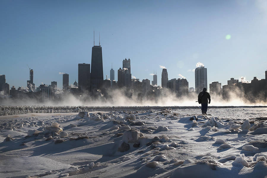 CHICAGO, ILLINOIS - JANUARY 30: A man walks along the lakefront as temperatures hovered around -20 degrees on January 30, 2019 in Chicago, Illinois. Businesses and schools have closed, Amtrak has suspended service into the city, more than a thousand flights have been cancelled and mail delivery has been suspended as the city copes with record-setting low temperatures.  (Photo by Scott Olson/Getty Images)