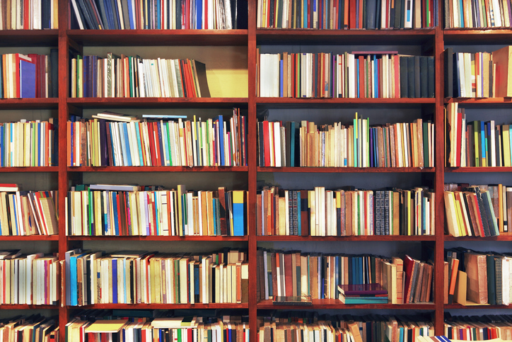 Old+books+in+a+secondhand+bookstore.+Some+of+them+are+peeling.Good+photo+to+be+used+as+a+background.