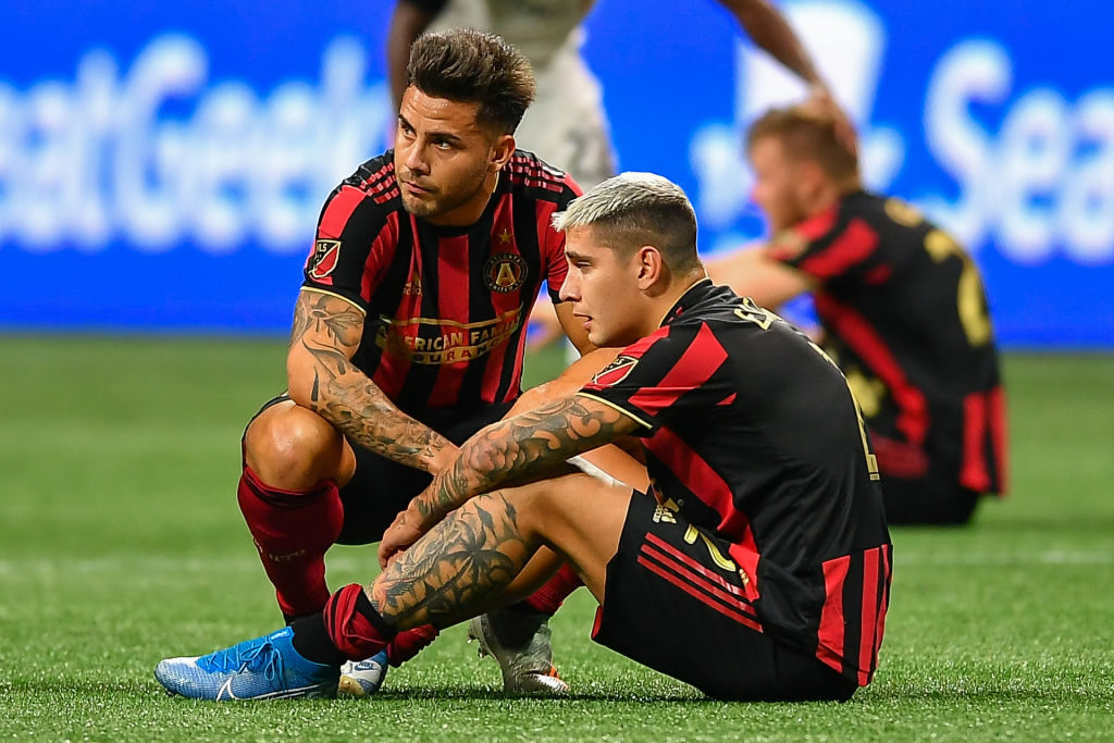 ATLANTA, GA - OCTOBER 30:  Atlanta's Hector Villalba (15) consoles teammate Franco Escobar (2) following the conclusion of the MLS playoff match between Toronto FC and Atlanta United FC on October 30th, 2019 at Mercedes-Benz Stadium in Atlanta, GA.  (Photo by Rich von Biberstein/Icon Sportswire via Getty Images)
