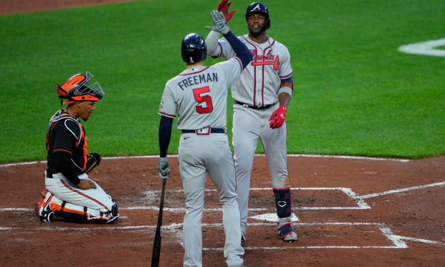 Aug 20, 2021; Baltimore, Maryland, USA; Atlanta Braves first baseman Freddie Freeman (5) congratulates designated hitter Jorge Soler (12) for hitting a home run during the third inning against the Baltimore Orioles at Oriole Park at Camden Yards. Mandatory Credit: Gregory Fisher-USA TODAY Sports