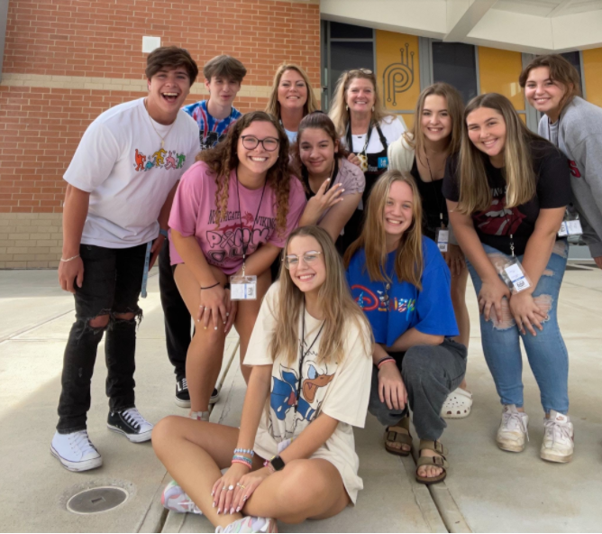 Yearbook Class poses for a picture alongside new advisor, Mrs. Lisa Morris